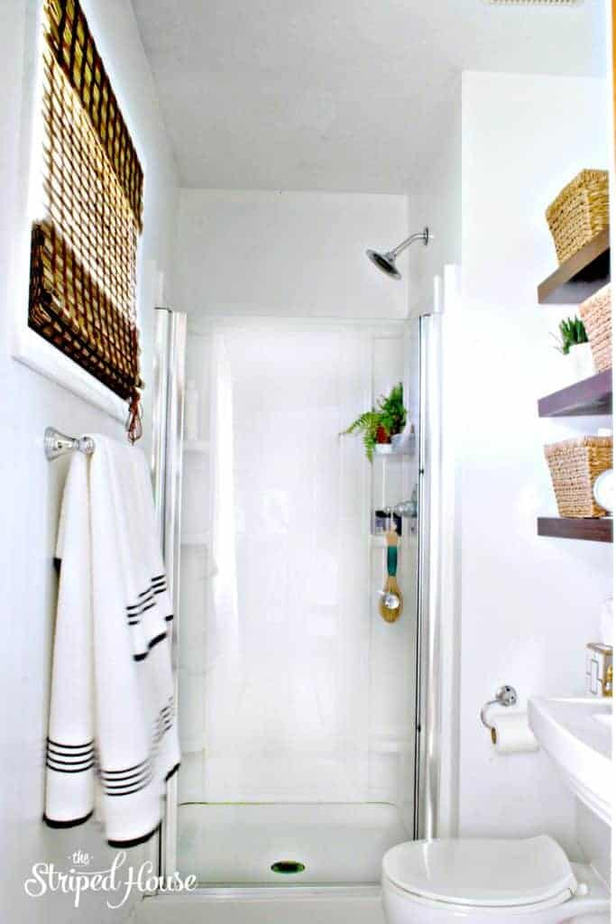 classic black and white master bathroom makeover - The Striped House