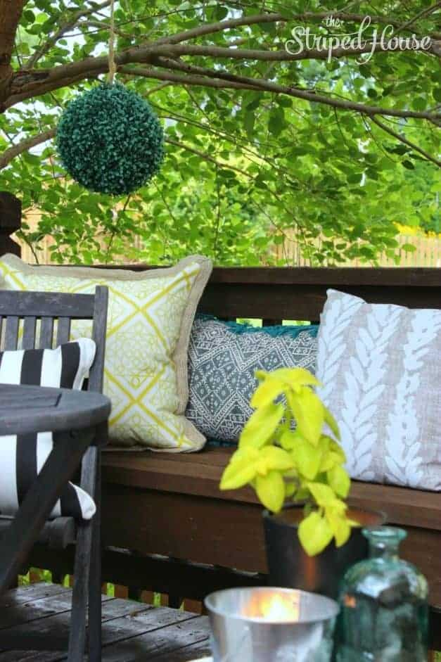 backyard deck bench seating pillows The Striped House