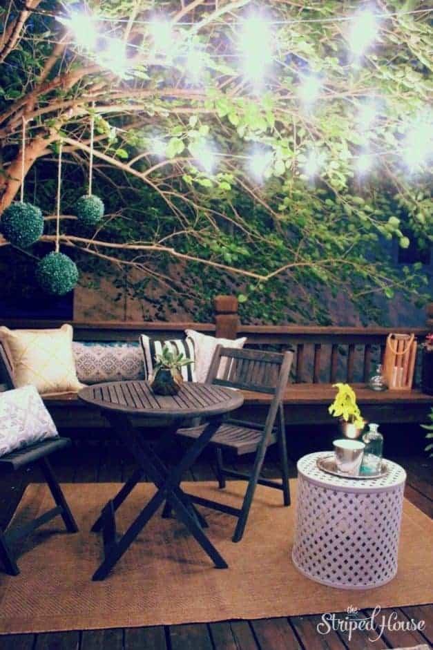 night cafe lights over backyard The Striped House