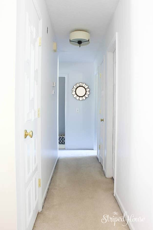 white-interior-doors-hallway-makeover-moulding-the-striped-house