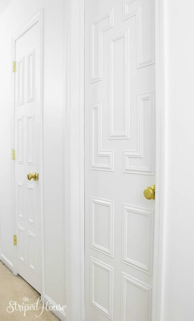 Makeover tutorial of plain flat front hollow core interior doors using decorative trim moulding and white paint.