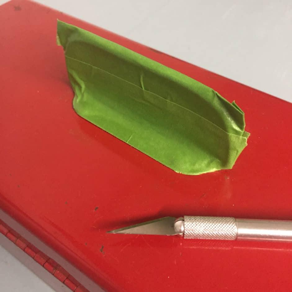 metal-tool-box-makeover-handle-tape-cut