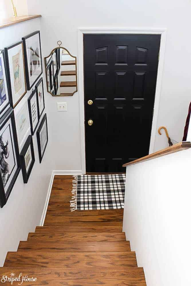 a modern traditional entry makeover in black and white with an inexpensive gallery wall