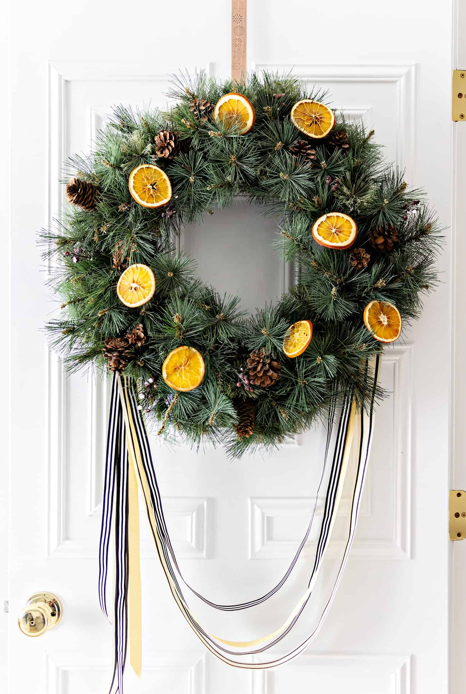 How to bake orange slices to use them in holiday decorating. I added them to a faux wreath and love how it turned out.